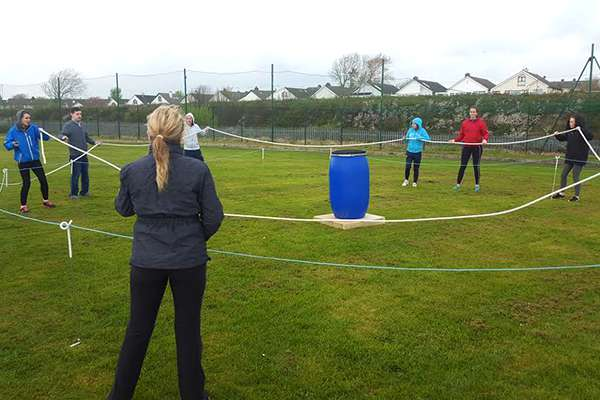 A group of co-workers engage in a group dynamic activity in Ballyloughane as part of a team-building excercise.