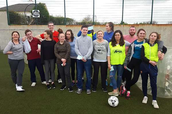 A group of co-workers enjoying a bubble football game at Astrobay Galway after a team-building excercise event.